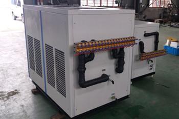 两台用于注塑机模具冷却的工业冷水机顺利出厂运行良好
